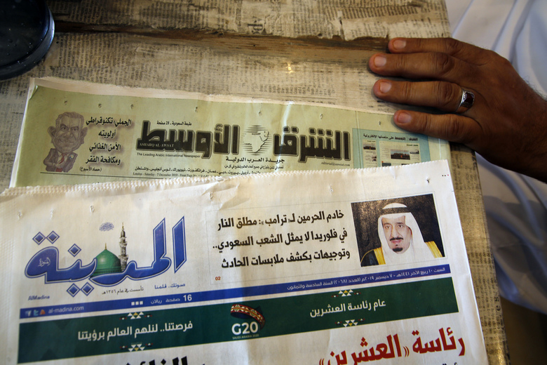 "Saudi daily Al-Madina newspaper fronted by a picture of Saudi King Salman is displayed at a coffee shop in Jiddah, Saudi Arabia, Saturday, Dec. 7, 2019. U.S. law enforcement officials were digging into the background of the suspected Florida naval station shooter Friday, to determine the Saudi Air Force officer's motive and whether it was connected to terrorism. Arabic reads ""King Salman to Donald J. Trump: Florida shooter does not represent the Saudi people."" (AP Photo/Amr Nabil)"