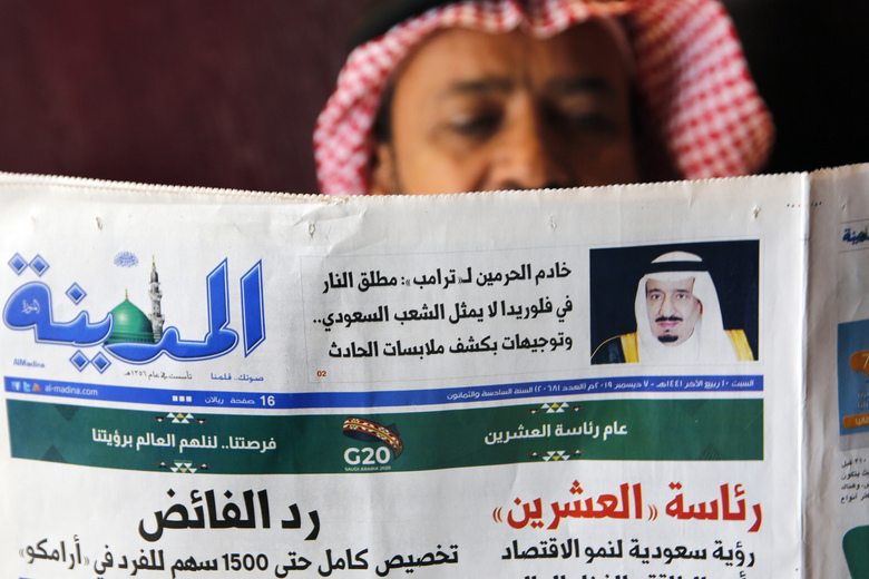 "A man reads the daily Al-Madina newspaper fronted by a picture of Saudi King Salman at a coffee shop in Jiddah, Saudi Arabia, Saturday, Dec. 7, 2019. U.S. law enforcement officials were digging into the background of the suspected Florida naval station shooter Friday, to determine the Saudi Air Force officer's motive and whether it was connected to terrorism. Arabic reads ""King Salman to Donald J. Trump: Florida shooter does not represent the Saudi people."" (AP Photo/Amr Nabil)"