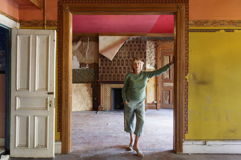"""This photo provided by Monacelli Press shows Suzanne Lipschutz inside an apartment in the Chelsea Hotel in New York and is featured in the book by Colin Miller and Ray Mock titled """"Hotel Chelsea: Living in the Last Bohemian Haven."""" The book is a big, colorful celebration of more than two dozen residents, their living spaces and their stories. (Colin Miller/Monacelli Press via AP)"""