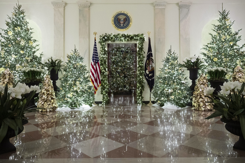 The official White House Christmas tree is decorated in the Blue Room seen through the Cross Hall, during the 2019 Christmas preview at the White House, Monday, Dec. 2, 2019, in Washington. (AP Photo/Alex Brandon)