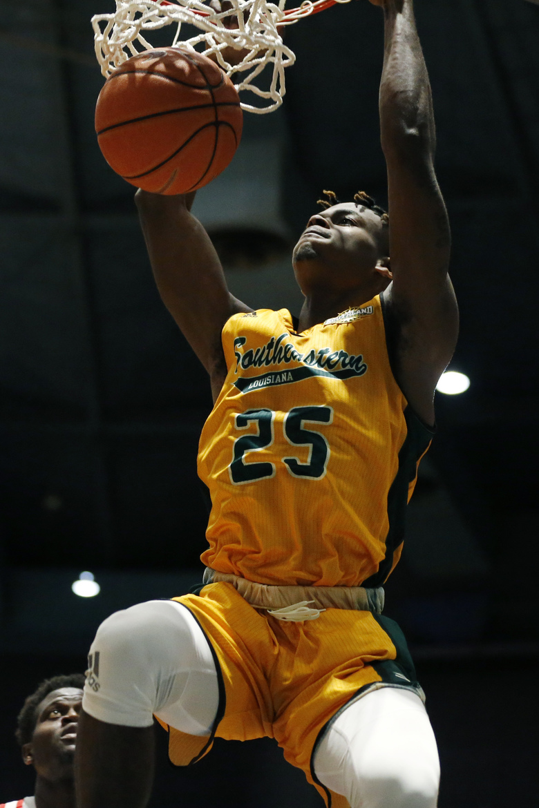 Southeastern Louisiana forward Ty Brewer (25) hangs on the basket after dunking against Mississippi during the second half of an NCAA college basketball game, Saturday, Dec. 21, 2019, in Jackson, Miss. Mississippi won 83-76.(AP Photo/Rogelio V. Solis)
