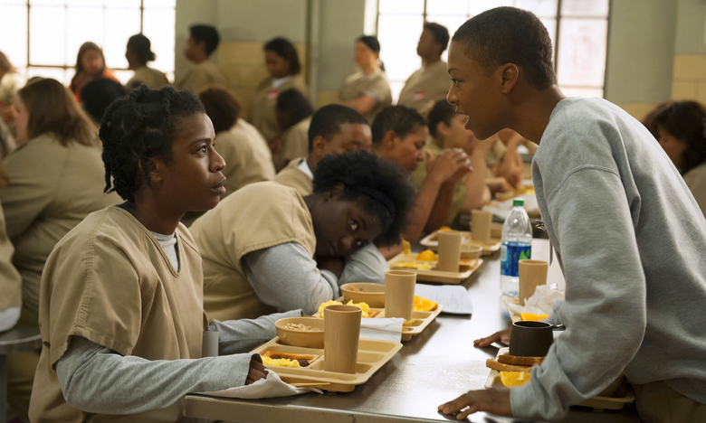 """FILE – In this file image released by Netflix, Uzo Aduba, left, and Samira Wiley appear in a scene from """"Orange is the New Black.""""  It took less than a decade for leader Netflix to skyrocket from about 12 million U.S. subscribers at the decade's start to 60 million this year and 158 million worldwide.  (Jojo Whilden/Netflix via AP, File)"""