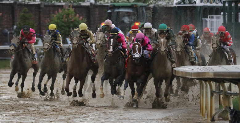 Luis Saez rides Maximum Security, second from right, to the finish line during the 145th running of the Kentucky Derby horse race at Churchill Downs, May 4, 2019, in Louisville, Ky. Country House was declared the winner after Maximum Security was disqualified following a review by race stewards. (AP Photo/John Minchillo)