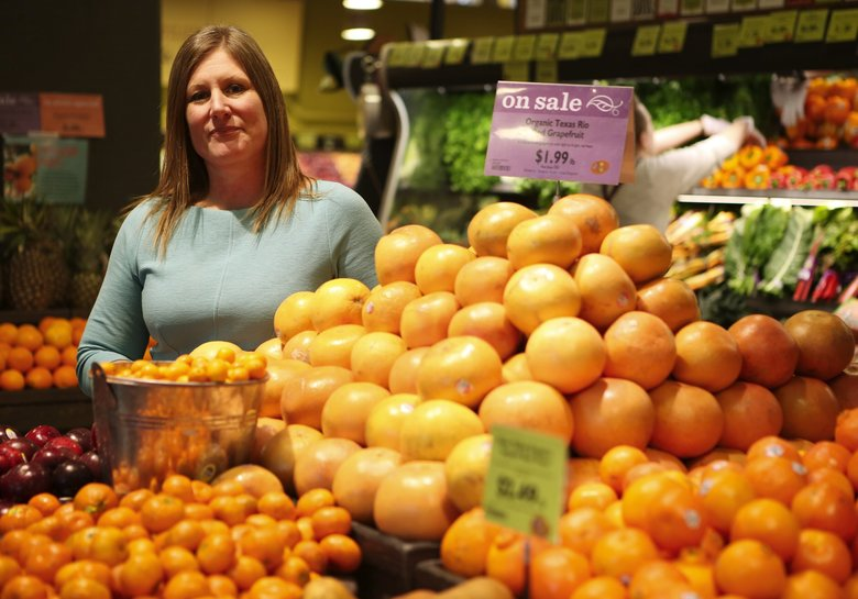 Cate Hardy, chief executive officer of PCC Natural Markets, at the Green Lake Village store in Seattle in 2016. PCC plans to open a store in the Central District after Portland-based New Seasons pulled out. (Ken Lambert / The Seattle Times, file)