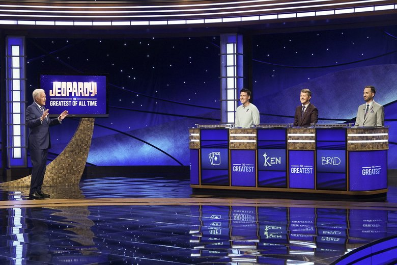 """Jeopardy!"" host Alex Trebek, left, with contestants James Holzhauer, Ken Jennings and Brad Rutter on the set of ""Jeopardy! The Greatest of All Time."" (Eric McCandless / ABC)"