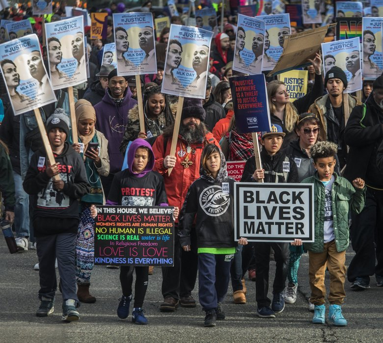 Children take the lead of last year's Martin Luther King Jr. march as it heads up Union Street toward downtown. (Steve Ringman / The Seattle Times, file)