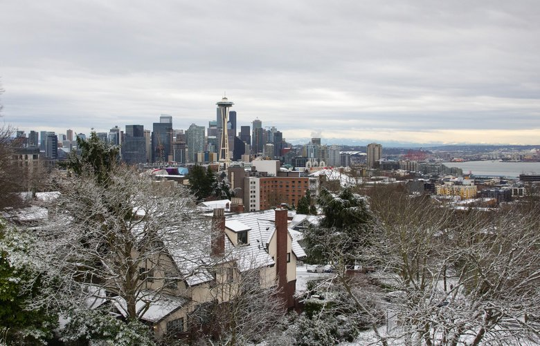 A couple hours after an afternoon snowstorm Wednesday, January 15, 2020, the view of the Seattle city skyline is totally clear.  Shot from Kerry Park.  (Second shot of two —  In the first one, the skyline is totally obscured).  212692