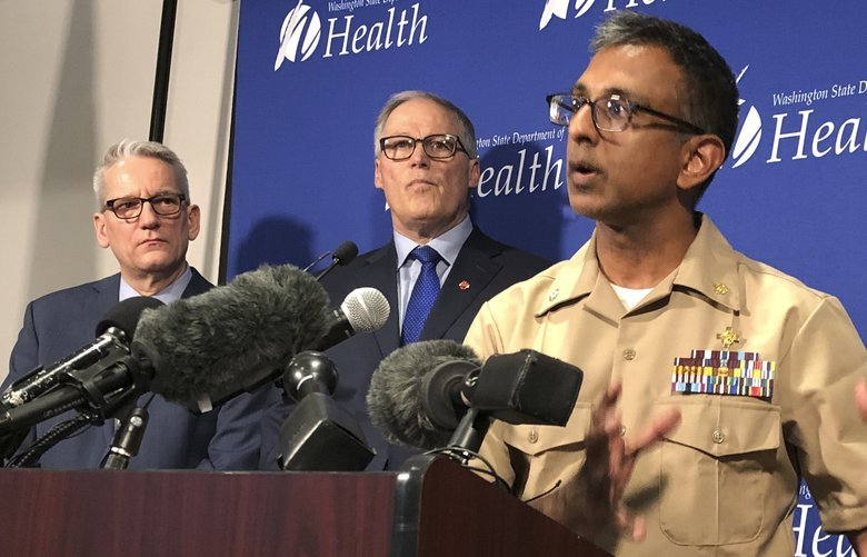 Satish Pillai, right, a medical officer for the CDC, speaks Tuesday Jan. 21, 2020, at a news conference in Shoreline, Wash., following the announcement that a man in Washington state is the first known person in the United States to catch a new type of coronavirus that officials believe originated in China. Looking on are Washington Gov. Jay Inslee, second from left, and John Wiesman,, left, Washington state Secretary of Health. The man who caught the virus is a Washington state resident who returned last week from China and is currently hospitalized near Seattle. (AP Photo/Carla K. Johnson) WATW103 WATW103