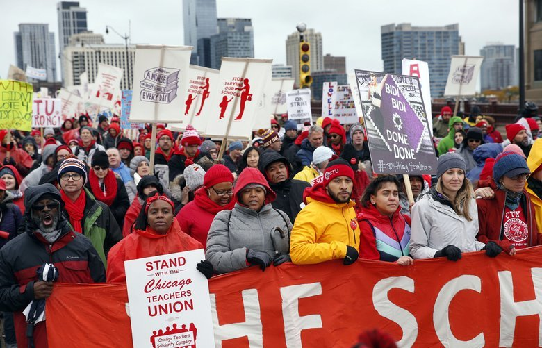 Chicago Teachers Union members and supporters march on Roosevelt Road, Wednesday, Oct. 30, 2019, in Chicago. (Kevin Tanaka/Chicago Sun-Times via AP) ILCHS336