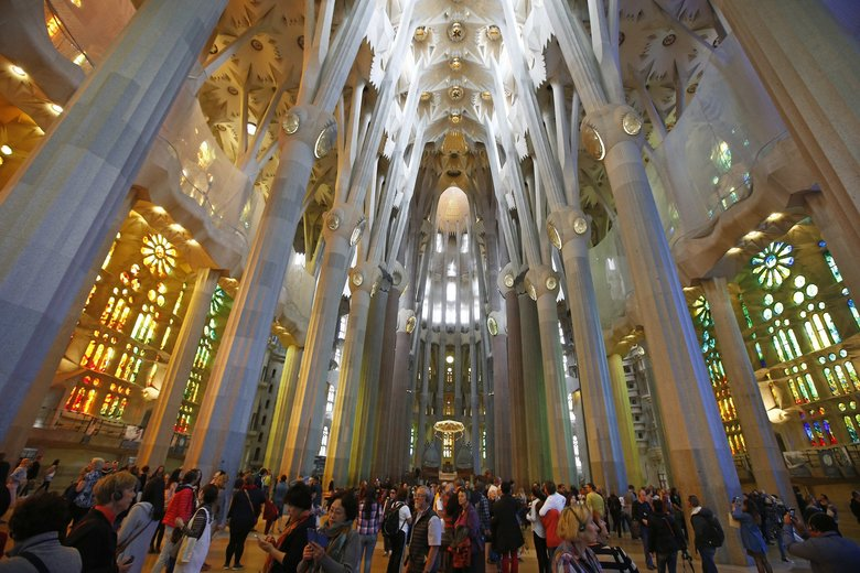 Tourists visit Sagrada Família, an unfinished basilica designed by Antoni Gaudí, in Barcelona, Spain. Spain recently surpassed the U.S. to become the second most-visited country in the world by international tourists. (Manu Fernandez / The Associated Press, 2015)