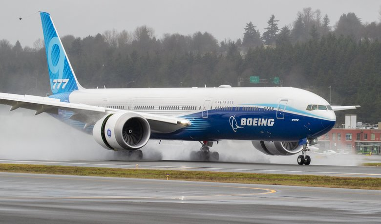 A Boeing 777X lands at Boeing Field in Seattle after its first flight on January 25, 2020. The 777X features giant carbon-composite wings, the largest Boeing has ever designed. The wings are so long that to fit at standard airport gates, each has to fold upward on a hinge 11 feet from the tip.  Photographed on January 25, 2020.  212736 (Mike Siegel / The Seattle Times)