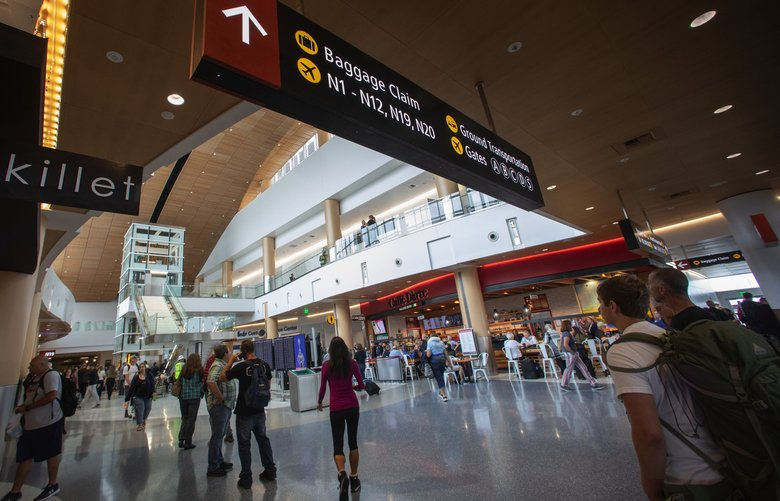 Seattle-Tacoma International Airport will be  screening passengers arriving from China for the Wuhan coronavirus. (Ellen M. Banner / The Seattle Times)