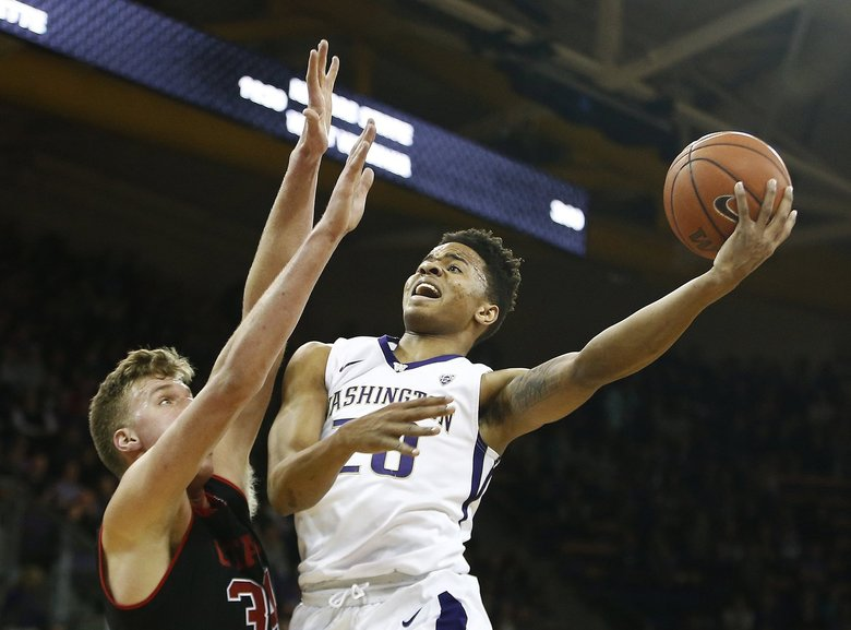 Washington Huskies guard Markelle Fultz (20) goes up for a contested layup during their Pac-12 game against the Utah Utes held at  Alaska Airlines Arena at Hec Edmundson Pavilion on Saturday, January 21, 2017.    (Logan Riely / The Seattle Times)