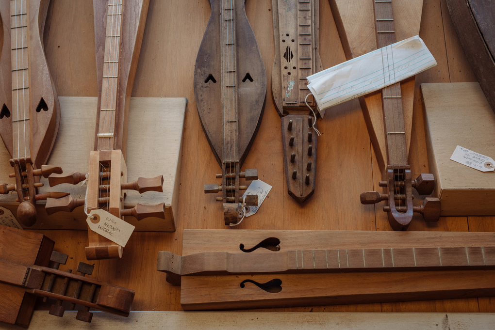 — PHOTO MOVED IN ADVANCE AND NOT FOR USE – ONLINE OR IN PRINT –  BEFORE SUNDAY, JAN. 5, 2020. — Historic dulcimers from the 19th and 20th centuries at the Appalachian School of Luthiery in Hindman, Ky. on Nov. 11, 2019. In Kentucky, where music is the lifeblood, an apprentice program run by luthiers provides meaningful jobs and helps remove the stigma of opioid addiction. (Mike Belleme/The New York Times)
