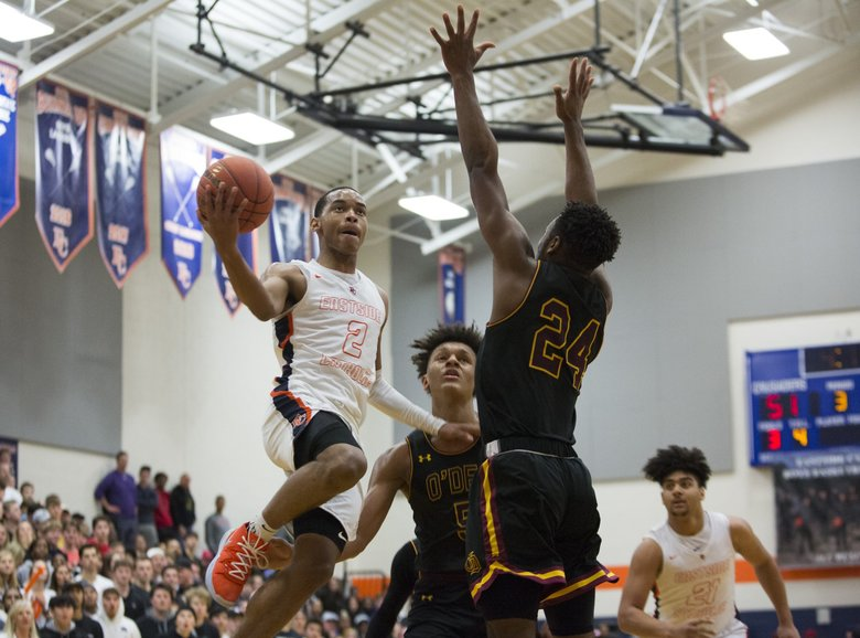 Eastside Catholic point guard Nolan Hickman (2) drives as O'Dea players Paolo Banchero (5) and Jermaine Davis defend during the second half Monday.  (Jason Redmond / The Seattle Times)