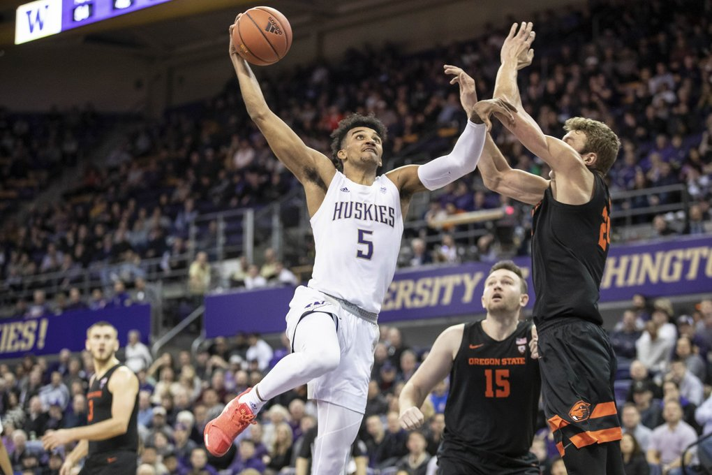 Jamal Bey has thoughts of going to the rim, but Oregon State's Kylor Kelley blocks the shot in the 2nd half. (Dean Rutz / The Seattle Times)