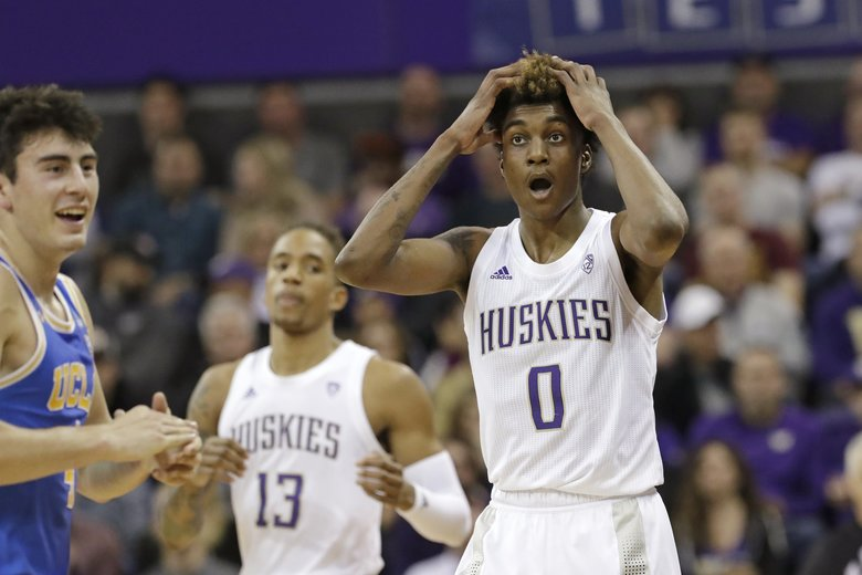 Washington's Jaden McDaniels (0) reacts after being called for a foul against UCLA's Jaime Jaquez Jr., left, in the first half of an NCAA college basketball game Thursday, Jan. 2, 2020, in Seattle. (AP Photo/Elaine Thompson) WAET103 WAET103 (Elaine Thompson / The Associated Press)