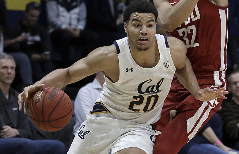 California's Matt Bradley (20) moves the ball ahead of Washington State's Tony Miller, right, during the second half of an NCAA college basketball game Thursday, Jan. 9, 2020, in Berkeley, Calif. (AP Photo/Ben Margot) CABM112 CABM112