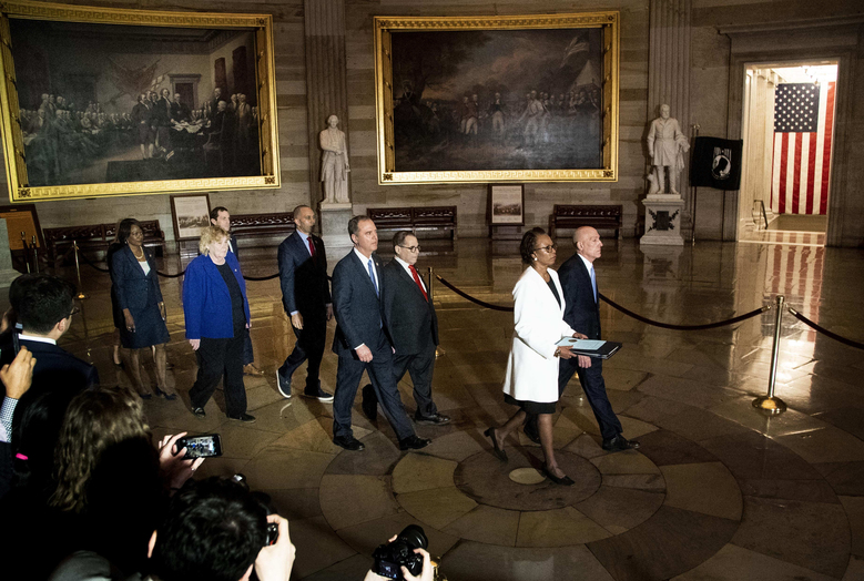 The House sergeant at arms, right, and clerk lead impeachment managers, including Reps. Adam Schiff, center left, and Jerrold Nadler, center right, through the Capitol Rotunda on Wednesday to deliver two articles of impeachment against President Trump to the Senate. (Washington Post photo by Melina Mara).