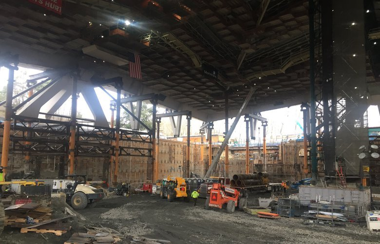 A look at construction in progress at KeyArena, where the roof is now entirely suspended by temporary posts as crews continue digging down.