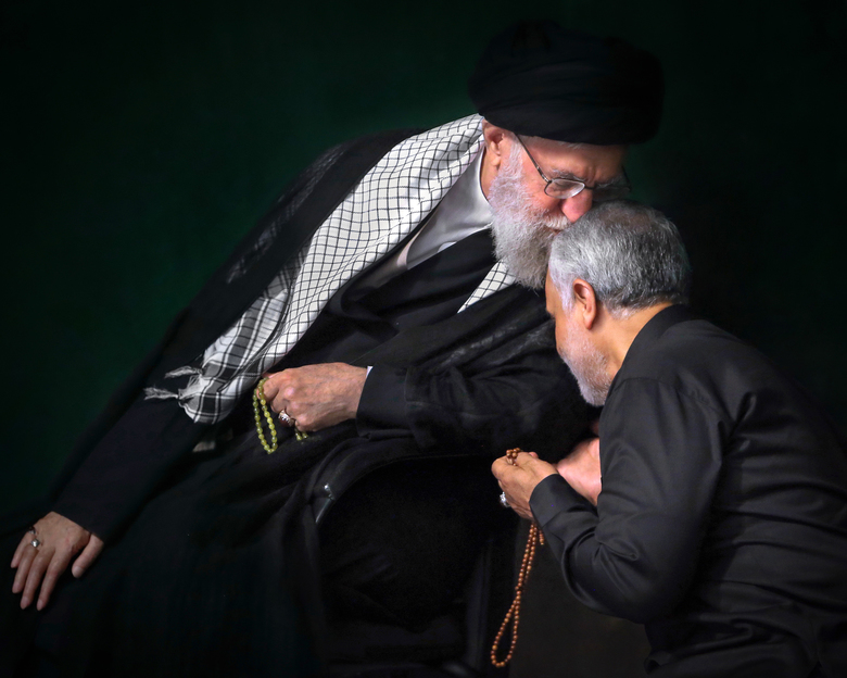 In this Sept. 19, 2018 photo, re-released Friday, Jan. 3, 2020, by an official website of the office of the Iranian supreme leader, Supreme Leader Ayatollah Ali Khamenei kisses head of the Iranian Gen. Qassem Soleimani during a religious ceremony in Tehran, Iran. The re-release of the photo occured hours after Soleimani and others were killed in a U.S. drone strike, Friday, in Baghdad, Iraq. Their relationship was so close that Khamenei was photographed more than once embracing Soleimani in ways that are customary in Iran for fathers and their beloved sons. (Office of the Iranian Supreme Leader via AP)