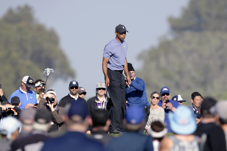 Tiger Woods walks on the tenth green of the Torrey Pines North Course during the first round The Farmers Insurance golf tournament in San Diego, Thursday, Jan. 23, 2020. (AP Photo/Alex Gallardo)