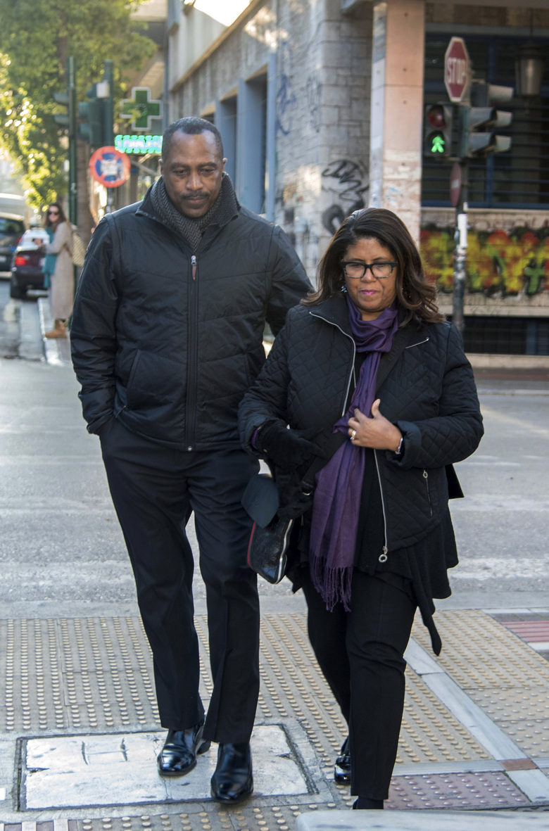 Phil and Jill Henderson parents of Bakari Henderson, arrive at the court house in Patras city, Greece, on Wednesday, Jan. 8, 2020.  A retrial is expected to begin for seven defendants on murder charges over the fatal beating of Texan tourist Bakari Henderson on an island resort in Greece in 2017. (AP Photo/Andreas Alexopoulos)