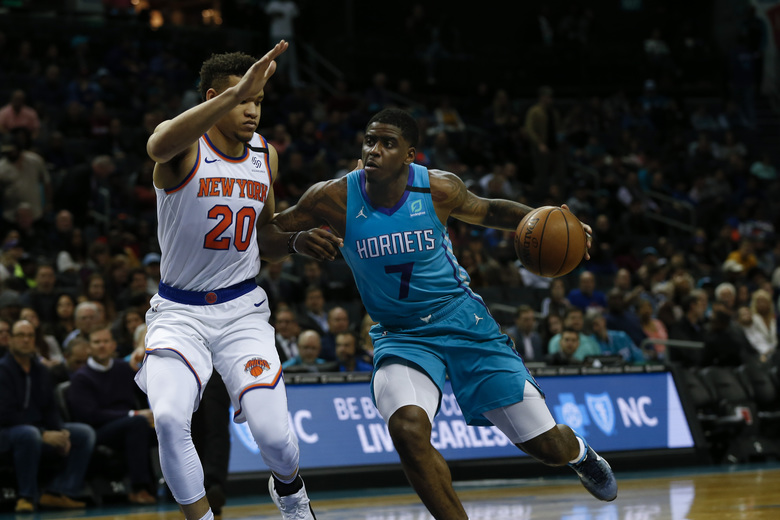 Charlotte Hornets guard Dwayne Bacon, right, drives into New York Knicks forward Kevin Knox II in the first half of an NBA basketball game in Charlotte, N.C., Tuesday, Jan. 28, 2020. (AP Photo/Nell Redmond)