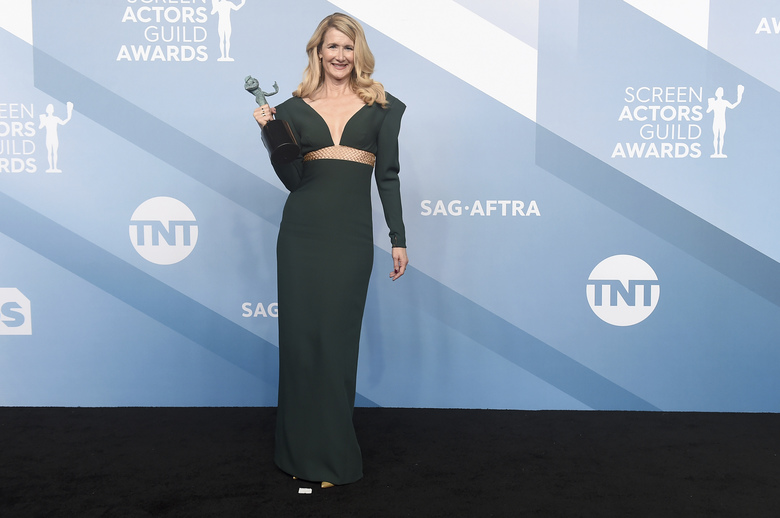 "Laura Dern poses in the press room with the award for outstanding performance by a female actor in a supporting role for ""Marriage Story"" at the 26th annual Screen Actors Guild Awards at the Shrine Auditorium & Expo Hall on Sunday, Jan. 19, 2020, in Los Angeles. (Photo by Jordan Strauss/Invision/AP)"