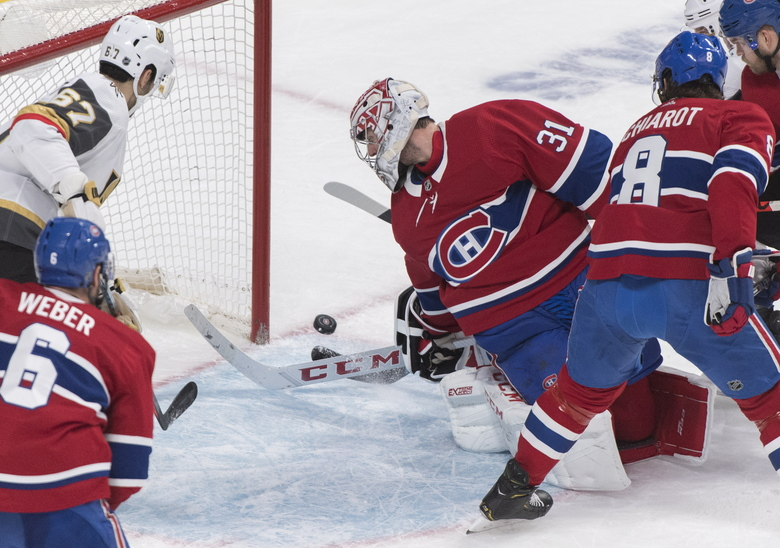 Montreal Canadiens goaltender Carey Price is scored against by Vegas Golden Knights' Paul Stastny (not shown) as Canadiens' Shea Weber (6) and Ben Chiarot (8) and Knights' Max Pacioretty look for the rebound during second-period NHL hockey game action in Montreal, Saturday, Jan. 18, 2020. (Graham Hughes/The Canadian Press via AP)