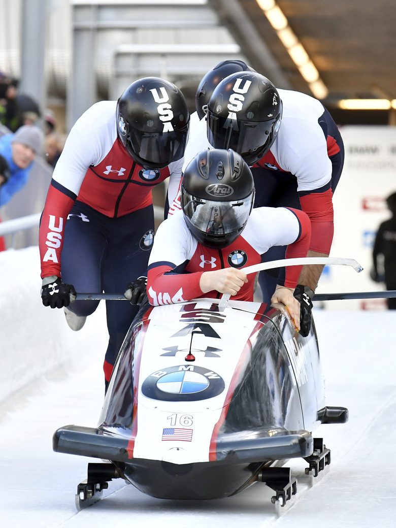 Pilot Hunter Church with Joshua Williamson, James Reed and Kristopher Horn of the United States start their first run of the men's four-man bobsled World Cup race in Igls, near Innsbruck, Austria, Sunday, Jan. 19, 2020. (AP Photo/Kerstin Joensson)