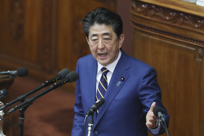 Japanese Prime Minister Shinzo Abe delivers a policy speech in Tokyo, Monday, Jan. 20, 2020. Abe said Monday that Japan will form a space defense unit to protect itself from potential threats as rivals develop missiles and other technology and the new unit will work closely with its American counterpart recently launched by President Donald Trump. (AP Photo/Koji Sasahara)