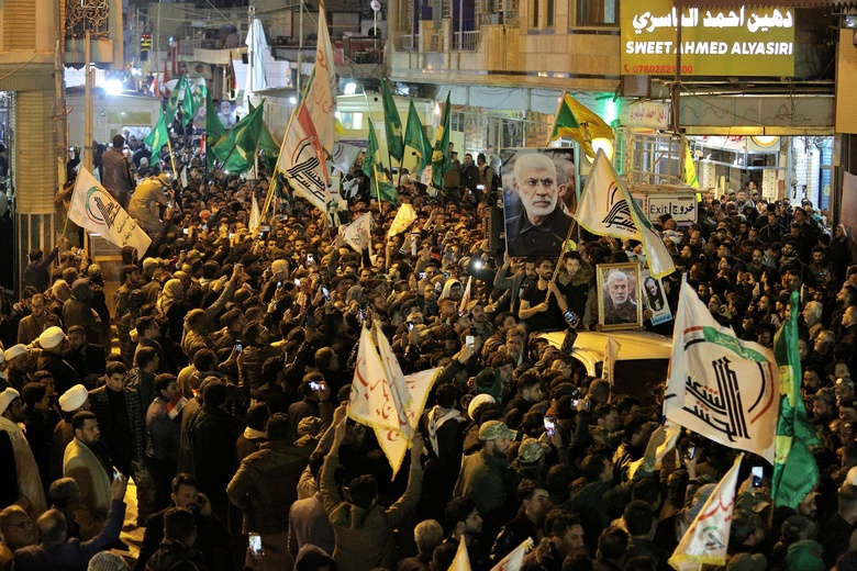 "Mourners carry the coffins of Iran's Gen. Qassem Soleimani and Abu Mahdi al-Muhandis, deputy commander of Iran-backed militias at the Imam Ali shrine in Najaf, Iraq, Saturday, Jan. 4, 2020. Iran has vowed ""harsh retaliation"" for the U.S. airstrike near Baghdad's airport that killed Tehran's top general and the architect of its interventions across the Middle East, as tensions soared in the wake of the targeted killing. (AP Photo/Anmar Khalil)"