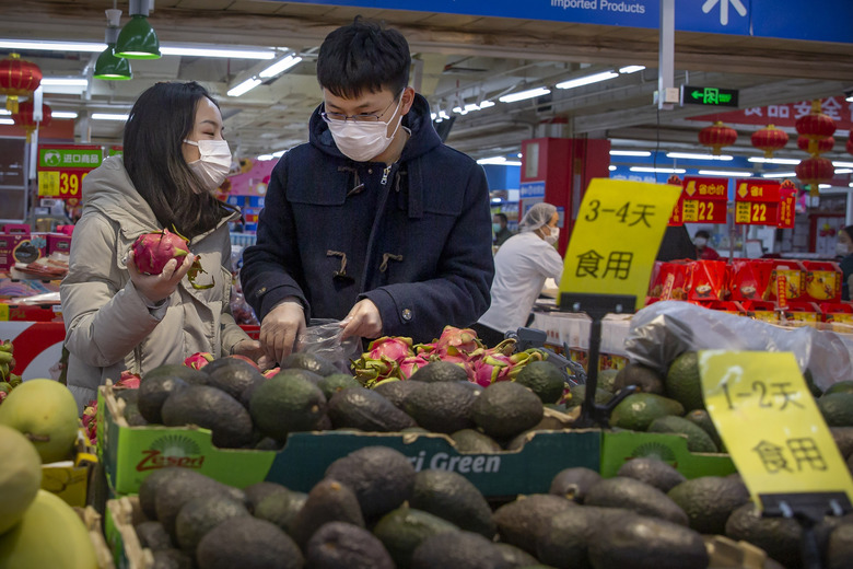 "People wear face masks as they shop at a grocery store in Beijing, Saturday, Feb. 1, 2020. China's death toll from a new virus rose to 259 on Saturday and a World Health Organization official said other governments need to prepare for""domestic outbreak control"" if the disease spreads in their countries. (AP Photo/Mark Schiefelbein)"