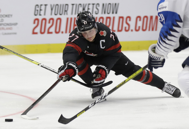 Canada's Barett Hayton controls the puck during the U20 Ice Hockey Worlds semifinal match between Finland and Canada in Ostrava, Czech Republic, Saturday, Jan. 4, 2020. (AP Photo/Petr David Josek)