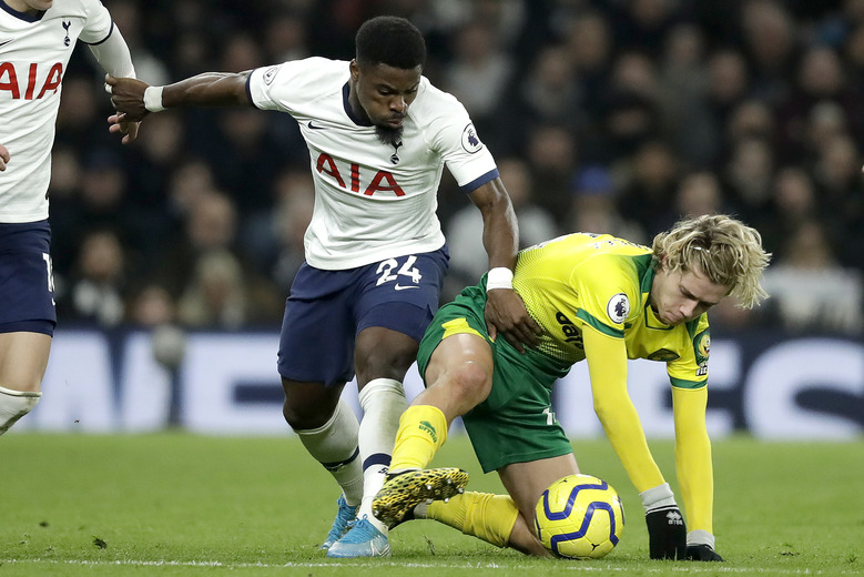 Tottenham's Serge Aurier, left, fights for the ball with Norwich City's Todd Cantwell during the English Premier League soccer match between Tottenham Hotspur and Norwich City at the Tottenham Hotspur Stadium in London, England, Wednesday, Jan. 22, 2020. (AP Photo/Matt Dunham)