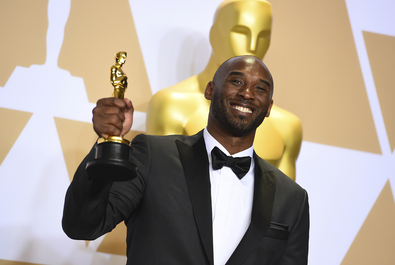 "FILE – This March 4, 2018 file photo shows Kobe Bryant, winner of the award for best animated short for ""Dear Basketball"",  at the Oscars in Los Angeles. Bryant, a five-time NBA champion and a two-time Olympic gold medalist, died in a helicopter crash in California on Sunday, Jan. 26, 2020. He was 41. (Photo by Jordan Strauss/Invision/AP, File)"