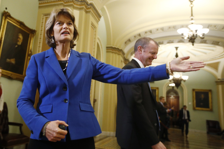 Sen. Lisa Murkowski, R-Alaska, gestures as she leaves the Senate chamber after the vote on witnesses during the impeachment trial of President Donald Trump at the U.S. Capitol Friday, Jan. 31, 2020, in Washington. The Senate rejected the idea of summoning witnesses for President Donald Trump's impeachment trial late Friday, all but ensuring his acquittal.  (AP Photo/Steve Helber)