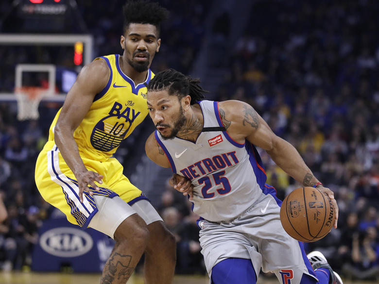 Detroit Pistons' Derrick Rose, right, drives the ball against Golden State Warriors' Jacob Evans (10) during the first half of an NBA basketball game Saturday, Jan. 4, 2020, in San Francisco. (AP Photo/Ben Margot)