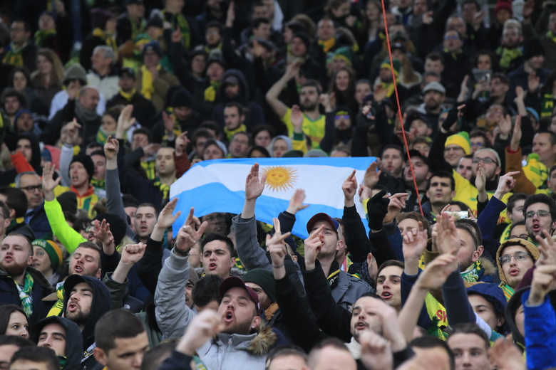 Nantes soccer supporters hold an Argentinian Jersey to pay tribute to late Argentinian soccer player Emiliano Sala prior the French League One soccer match between Nantes against Bordeaux in Nantes, western France, Sunday, Jan. 26, 2020. Nantes paid an emotional tribute to Emiliano Sala by wearing a special blue and white shirt representing the Argentina team's colors during its home game against Bordeaux. Sala died after the single-engine aircraft carrying him from Nantes to his new club Cardiff crashed near the Channel Island of Guernsey on Jan. 21 last year. (AP Photo/Michel Euler)