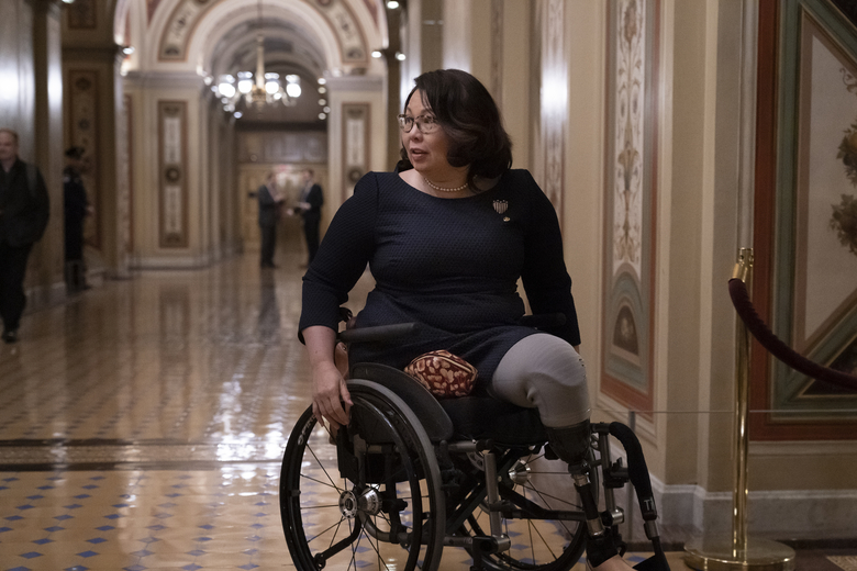 Sen. Tammy Duckworth, D-Ill., departs the Capitol, late Wednesday, Jan. 22, 2020, following arguments in the impeachment trial of President Donald Trump on charges of abuse of power and obstruction of Congress, in Washington. (AP Photo/J. Scott Applewhite)