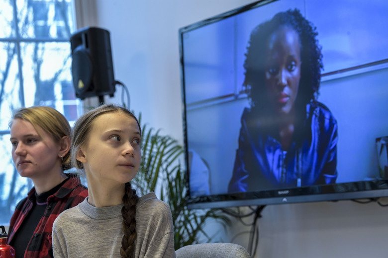 Climate activist Vanessa Nakate, right, speaks via video-link as Ell Ottosson Jarl and Greta Thunberg, center, also attend a press conference with climate activists and experts from Africa in Stockholm, Sweden, Friday Jan. 31, 2020. Ugandan climate activist Vanessa Nakate and peers from other African nations on Friday made an urgent appeal for the world to pay more attention to the continent that stands to suffer the most from global warming despite contributing to it the least. (Pontus Lundahl/TT via AP)
