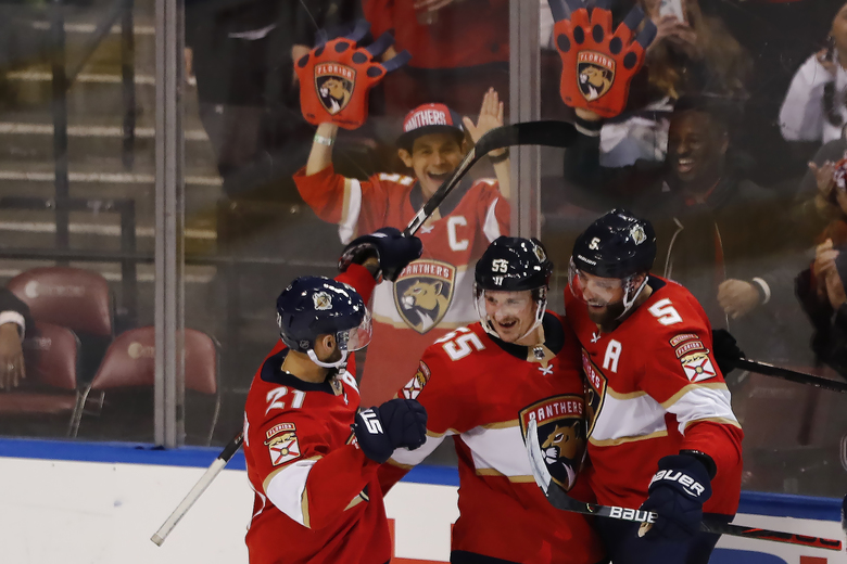 Florida Panthers center Noel Acciari (55) celebrates with center Vincent Trocheck (21) and defenseman Aaron Ekblad (5) after scoring during the third period of an NHL hockey game against the Vancouver Canucks, Thursday, Jan. 9, 2020, in Sunrise, Fla. (AP Photo/Brynn Anderson)