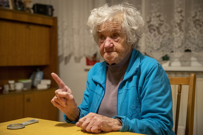 In this photo taken Friday, Jan. 24, 2020, Nazi camps survivor Marija Frlan, who will turn 100 on the Holocaust Remembrance day, talks to the Associated Press during an interview at her home in Rakek, Slovenia. Frlan, who was held at the Ravensbruck camp in northern Germany for over a year in 1944-45, will join other survivors and officials in Poland on Monday for the ceremonies marking the 75th anniversary of the liberation of the Auschwitz camp. (AP Photo/Darko Bandic)