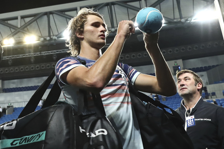 Germany's Alexander Zverev signs autographs after defeating Italy's Marco Cecchinato in their first round singles match at the Australian Open tennis championship in Melbourne, Australia, Tuesday, Jan. 21, 2020. (AP Photo/Dita Alangkara)