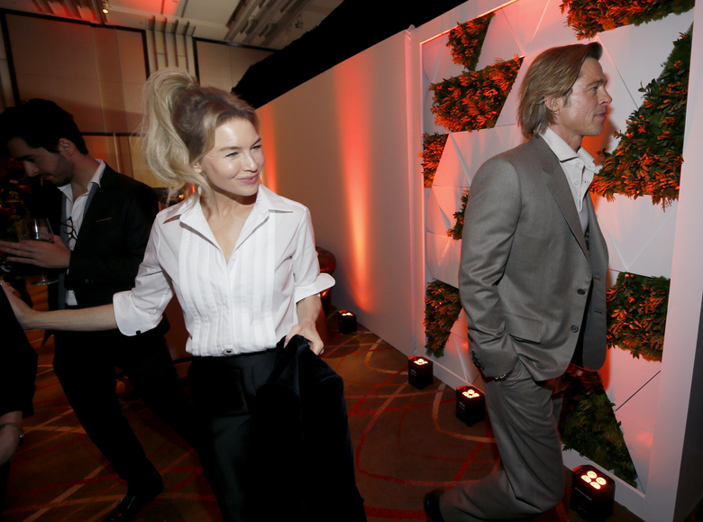 Renee Zellweger, left, and Brad Pitt are seen at the 92nd Academy Awards Nominees Luncheon at the Loews Hotel on Monday, Jan. 27, 2020, in Los Angeles. (Photo by Danny Moloshok/Invision/AP)