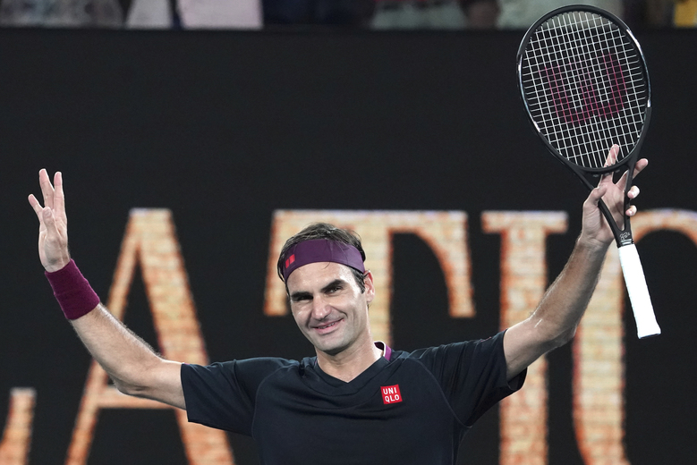 Switzerland's Roger Federer celebrates after defeating United States' Steve Johnson during their first round singles match at the Australian Open tennis championship in Melbourne, Australia, Monday, Jan. 20, 2020. (AP Photo/Lee Jin-man)