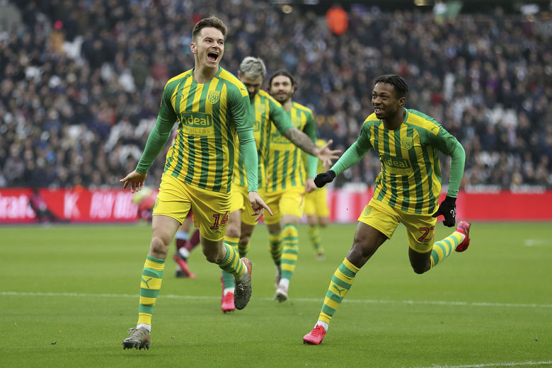 West Bromwich Albion's Conor Townsend celebrates scoring his side's first goal of the game during  the FA Cup fourth soccer round match between Wet Ham United and West Bromwich Albion at the London Stadium, London. Saturday Jan. 25, 2020. (Bradley Collyer/PA via AP)
