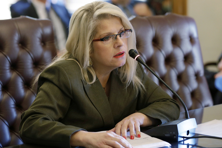 FILE – In this Jan. 28, 2015, file photo, Sen. Linda Collins-Smith, R-Pocahontas, speaks at the Arkansas state Capitol in Little Rock, Ark. A woman charged with killing the former Arkansas state lawmaker faces new charges alleging that she asked fellow inmates to kill the victim's ex-husband. Authorities on Tuesday, Jan. 14, 2019, charged Rebecca Lynn O'Donnell with two counts of criminal solicitation to commit capital murder and two counts of criminal solicitation to commit tampering with physical evidence. (AP Photo/Danny Johnston, File)