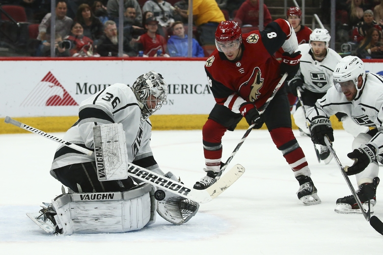 Los Angeles Kings goaltender Jack Campbell (36) makes a save on a shot by Arizona Coyotes center Nick Schmaltz (8) as Kings center Anze Kopitar (11) and defenseman Derek Forbort (24) watch during the second period of an NHL hockey game Thursday, Jan. 30, 2020, in Glendale, Ariz. (AP Photo/Ross D. Franklin)
